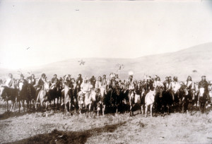 "Nez Perce group known as ""Chief Joseph's Band"", Lapwai, Idaho, spring, 1877 A large group of men on horseback with mountains in the background. In the front center of the group can be seen Chief Joseph, White Bird, and Looking Glass. (Number: L94-7.105; Collection: Roy Berk; Contributor: University of Washington Libraries; Repository: Northwest Museum of Arts and Culture.)"
